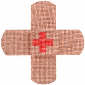 Two bandaids laid in a plus sign with a red cross sign in the center